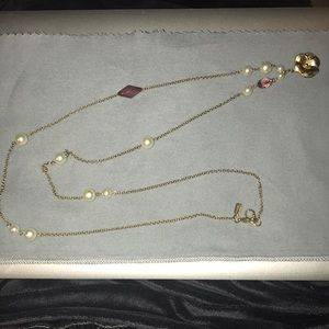 Long pearl necklace with pink gems